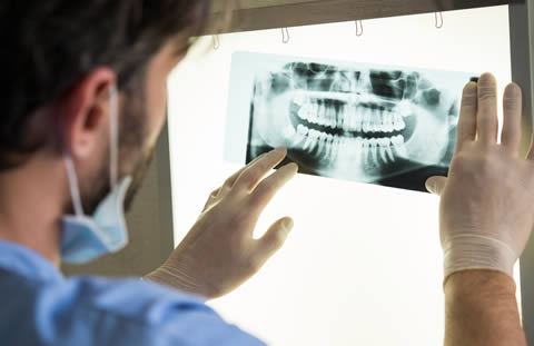Dentist with x-ray